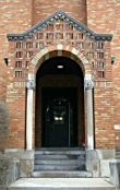An arched doorway over an entrance to the St. Thomas Parish School in Ann Arbor, MI