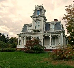 Second Empire house in Bangor, Maine, with a front porch that provides some setback, so the mansard roof is not as dominating.