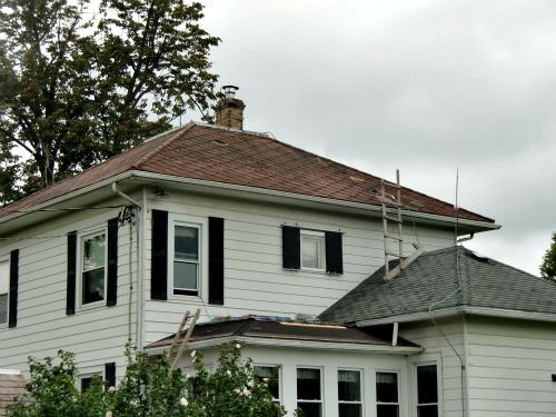 DIY Roofing - Work has begun on the lower roof, but not on the middle roof