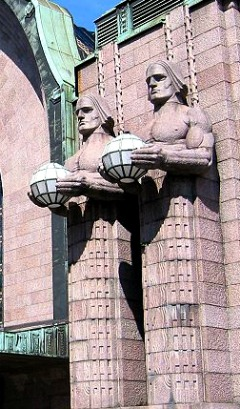 Art Nouveau Helsinki Central Railway Station by Eliel Saarinen has giant guards in the form of lamp holders