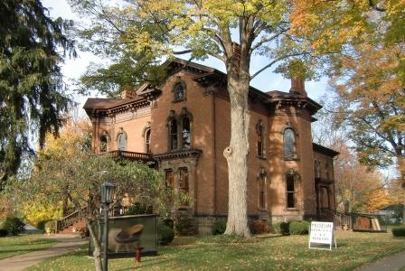Note the paired windows and the angled bay windows in this Brick Italianate in  Jonesville, MI