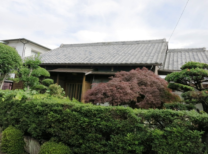 Well-formed hedges will do the trick where stone is not in the budget. Japan houses are usually coupled with private gardens.