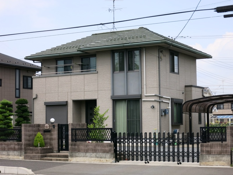 This Japan House is mostly modern, but softened with a hipped roof that evokes traditional Japanese architecture.