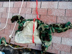 DIY Roofing Safety Harness - The chain near the glove is my tie in to the wall, courtesy a deck screw and a large washer