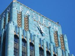 A blue building stands out in a city of grey. Art Deco Architecture could be bold in its use of color.