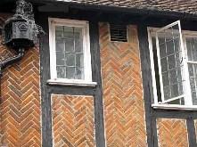 Herringbone pattern brick bond used in half-timbered house