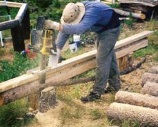 Jon milling the logs with a chainsaw.