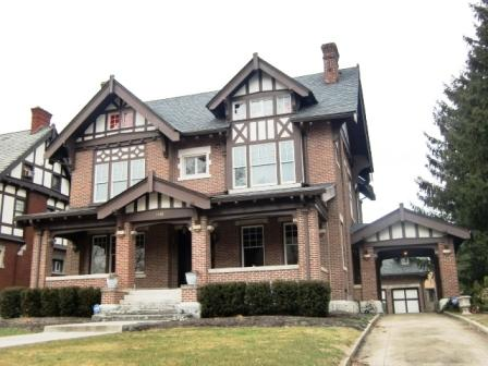 A Tudor house in Columbus, OH with drive-through porch