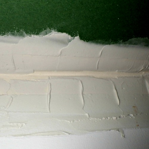 Drywall tape with mud being applied over it