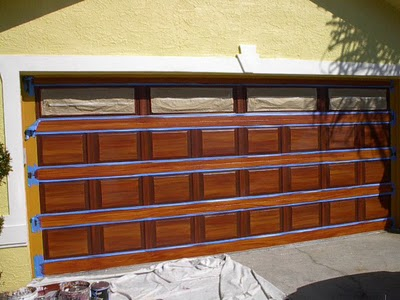 How to paint a metal garage door to look like wood for Faux painted garage doors