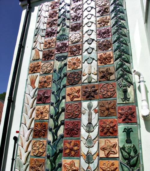 This is an exterior wall of Kay Aplin's Ceramic House.  Those are Tiles.