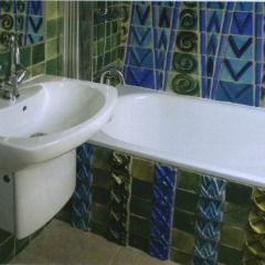 Ceramic Artist Kay Aplin went all out with this bathroom tile design using custom tiles