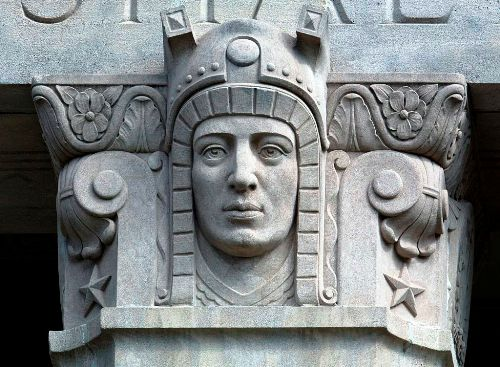 This is a war memoria, so this Art Deco bust probably has something to with Mars or the warrior spirit.  He certainly isn't a modern warrior.