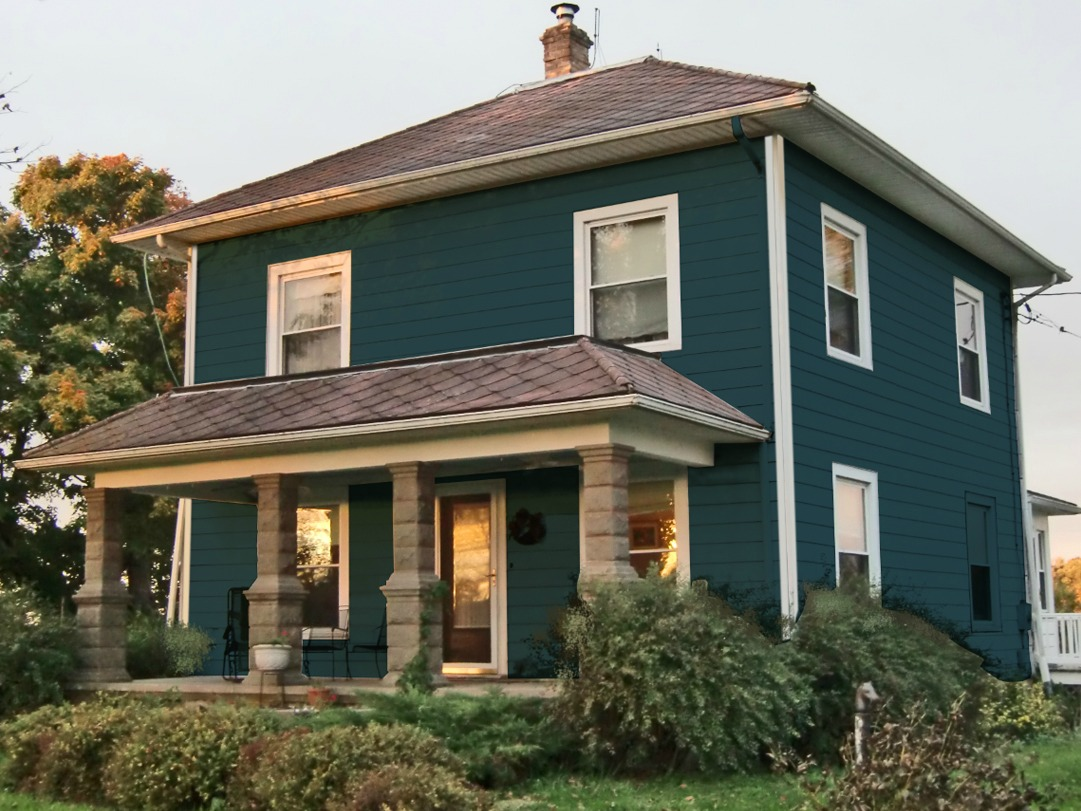 My house simulated in a gray blue paint but I removed the shutters