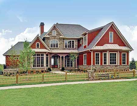 A red house with a stone covered core.