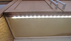 Under-counter LED lighting in an accessible kitchen.