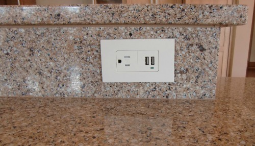 A siltstone counter and an accessible outlet.  The outlet includes USB chargers for their phones.