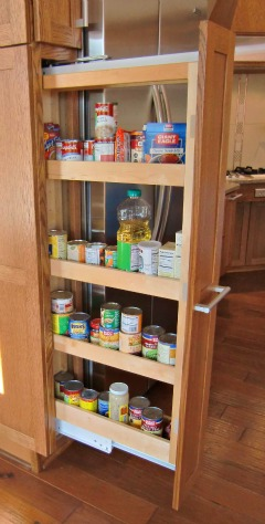 This Kraftmaid spice rack can be accessed from either side