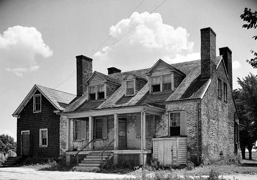 Four corner chimneys make this house.