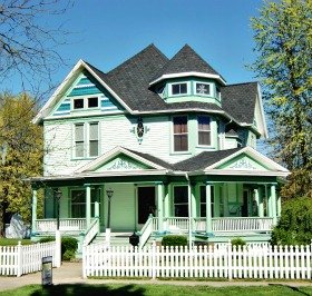 White may be the dominant color but its the greens that give this Queen Anne home its flavor.  Ada, Ohio.