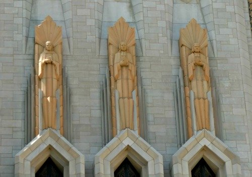 Art Deco statues that stand high above the entrance to Boston Avenue Methodist