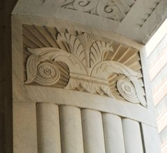 Art Deco Classical Square Column ending in a bas relief carving in lieu of a capital