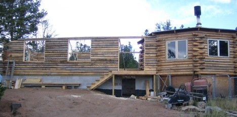 View of the log home with the walls to the top of the windows