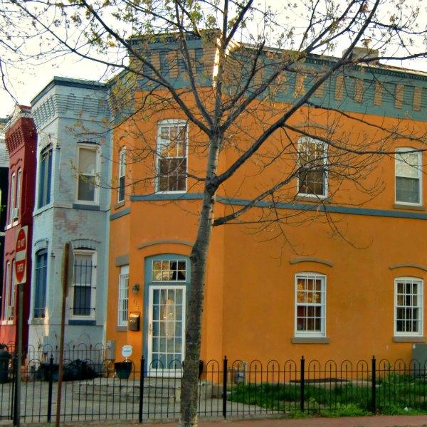 Orangish-Yellow townhouse in DC.