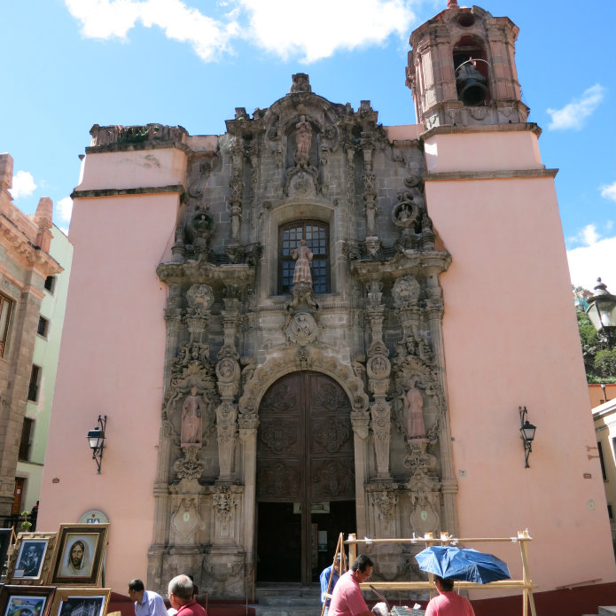 The facade of the Church of San Diego is decorated in a style known as Churriguresque