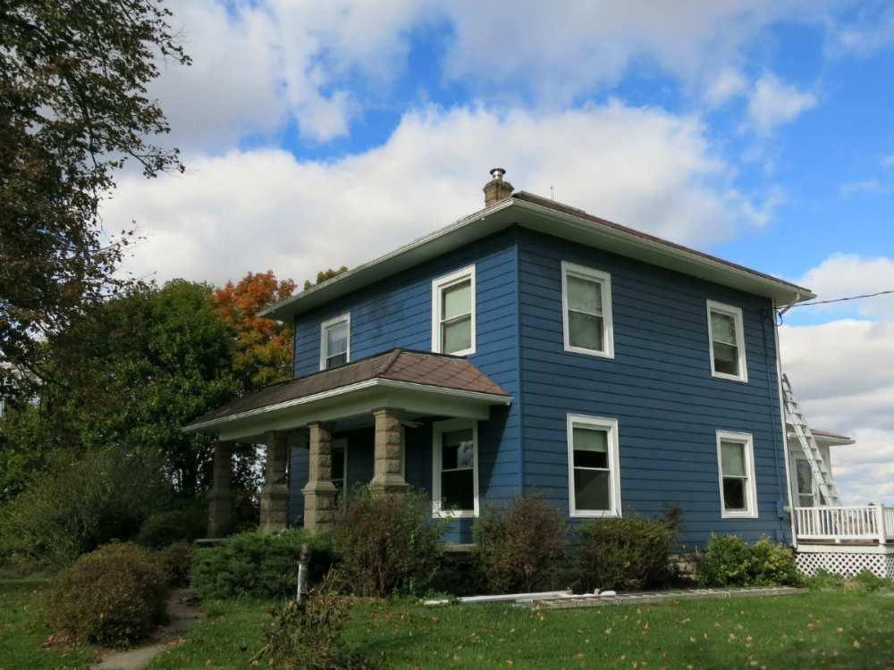 My house with the aluminum siding painted blue, but absent the trim