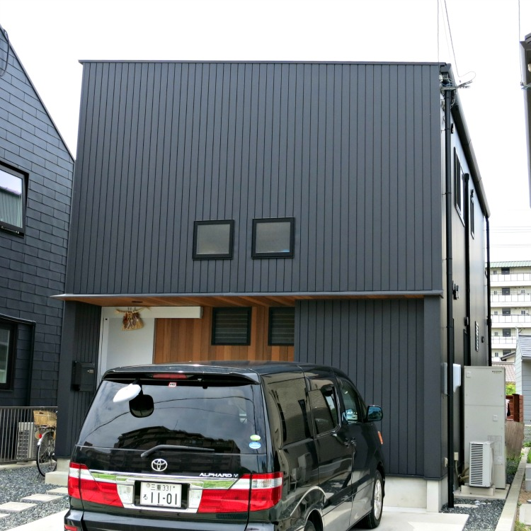 A Japan home with vertical metal siding.  This house is exceptionally boring and must be very dark inside.