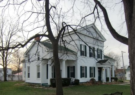 This home started out as a simple Cape Cod but the builder transformed it into a Greek Revival mansion to lure his bride to the wilds of Michigan.