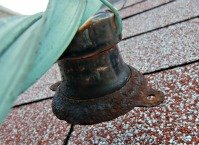Lightning Rod Strap and Insulator - The anchor plates were rusted.  This one is still useable