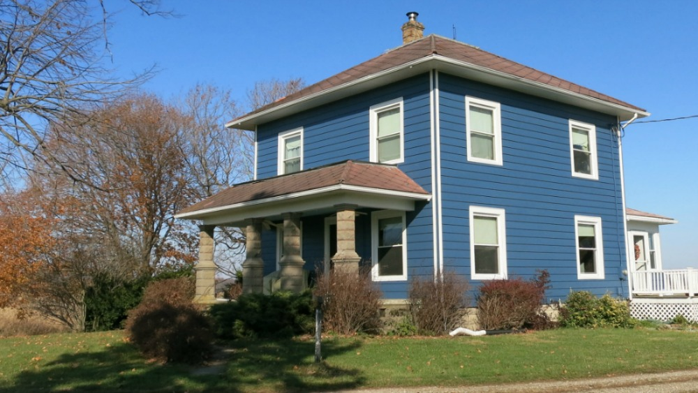 My house after I painted the aluminum siding blue