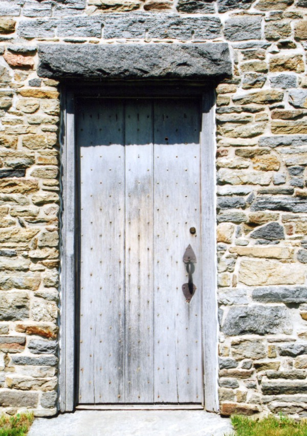 A rustic house deserves a rustic door, and this one delivers.