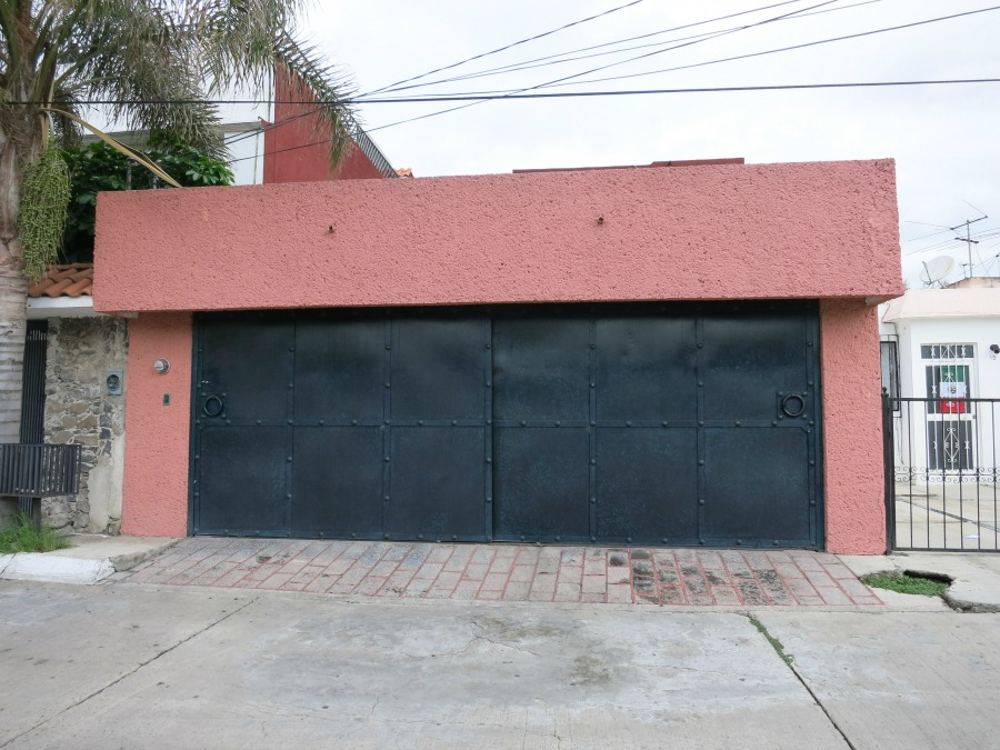 This is really a double-wide garage, but the massive, riveted metal doors are a common style for garages and gates alike.