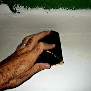 Sanding drywall with a foam block