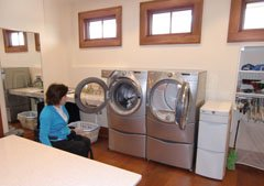 Good laundry room ideas include ergondynamically elevated front-loading washer and dryer - this makes it accessible for everyone