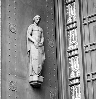 A statue representing Security guards the Davidson County Courthouse, an Art Deco building