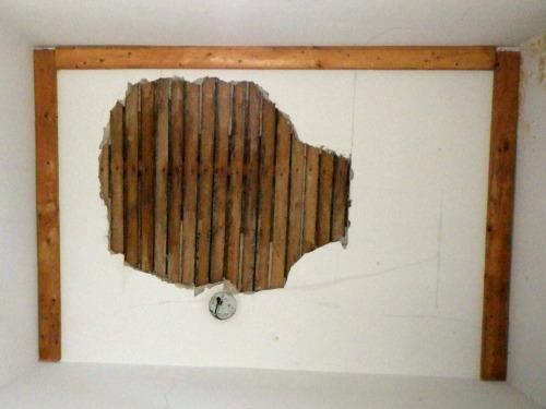 Closet ceiling minus damaged plaster.