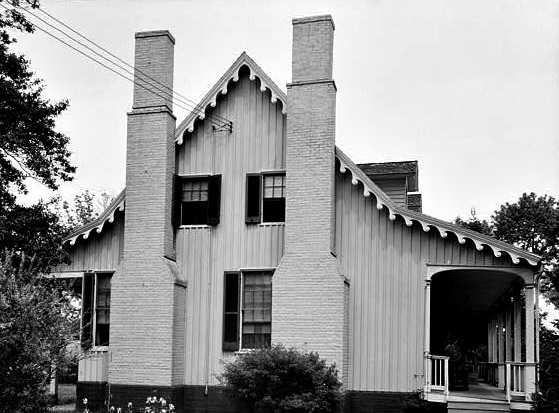 Tidewater home with two chimneys crowding the windows