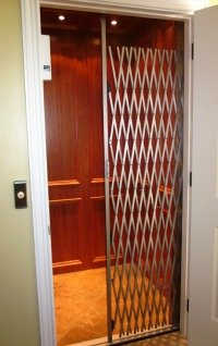 Most residential elevators will have a protective grate or door that travels with the cab.