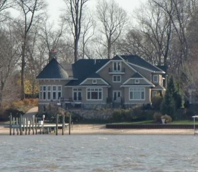 A grand home on the lake at Holland, MI has a hint of the Victorian in its layoug