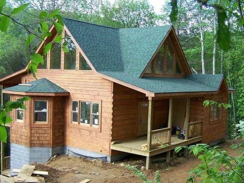 Modern log home with squared logs