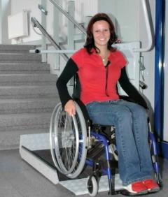 A wheelchair platform lift demonstrated - photo courtesy of Savaria.com