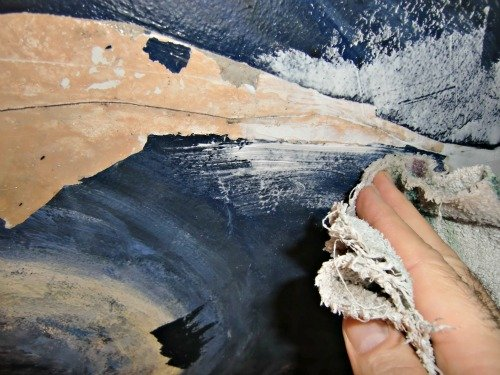 Wiping off excess caulk and spackling is part of the plaster ceiling repair